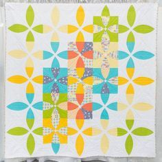 """Take a peek at """"Picnic Petals"""" by @wholecirclestudio which was featured at #quiltcon 2016. She says """"Picnic Petals was inspired by the traditional flowering snowball quilt pattern. When laying out the quilt blocks and colors I looked at many photos of pinwheels and flowersobjects that reminded me of the shapes in the fabric and that conveyed movement. This pattern encouraged me to work with fabric patterns and techniques I didn't normally work with."""" . . . Remember that QuiltCon 2017…"""