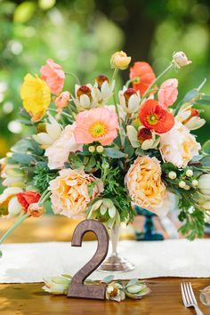 This vibrant centerpiece by Knot Just Flowers features one more stunning seasonal flower to consider: poppies. Their bright colors and whimsical appeal are a lovely addition to all kinds of arrangements.