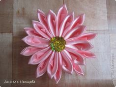 Kanzashi: the directions are in Russian, but the pictures are clear and easy to follow. Lovely!