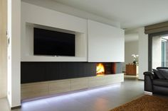 The wooden furniture in the design of your gas - or wood-built-in together with ecological and sustainable. Home Fireplace, Modern Fireplace, Fireplaces, Painel Tv Sala Grande, Fireplace Feature Wall, Living Room Entertainment Center, Tv Decor, Home Decor, Tv Wall Design