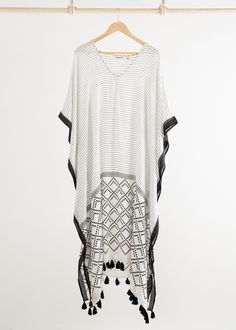 Effortless and so easy to wear, a chic kaftan can be worn through straight from…
