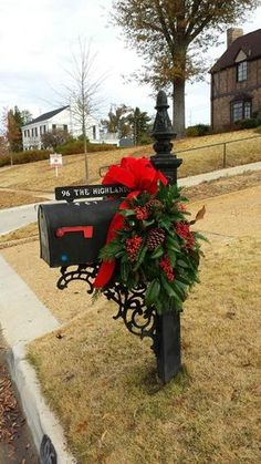 Traditional large mailbox saddle from Andy's Creekside Nursery in Vestavia Hills, AL. Mixed greenery - Frasier fir, little gem magnolia, red nandina berries, cedar and red velvet bow. Christmas Mailbox Decorations, Christmas Centerpieces, Fall Mailbox Decor, Mailbox Decorating, Mailbox Swag Christmas, Holiday Decorating, Decorating Ideas, Decor Ideas, Christmas Swags