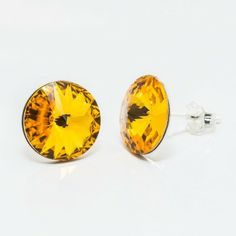 Swarovski Rivoli Earrings 12mm Sunflower  Dimensions: length:1,8cm stone size: 12mm Weight ~ 2,66g ( 1 pair ) Metal : sterling silver ( AG-925) Stones: Swarovski Elements 1122 12mm Colour: Sunflower 1 package = 1 pair Silver Jewelry, Swarovski, Stones, Colour, Sterling Silver, Metal, Earrings, Rocks, Color