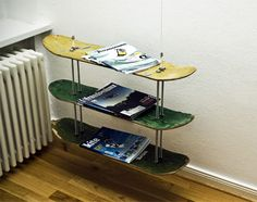 Selfmade magazine rack made with three skateboards. The decks are combined with four thread rods and the whole thing is hanging down from the ceiling.