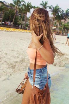 Cute outfit. Orange tube top. Blue jean shorts.