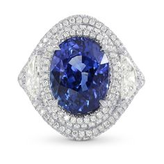 A magnificent sapphire and diamond ring mounted in Platinum. The oval sapphire is certified by GRSas a vivid royal blue (Heated), weighing 6.66Ct. The setting is adorned with 0.82Ct TWcollection color white half-moon diamonds and 0.75Ct TWcollection color white round brilliants. For more information about this item please contact our customer service department.