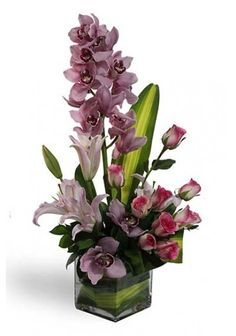 spectacle of beauty and fresh color, this bouquet of cymbidium orchids is a picture perfect way to convey your every emotion. cymbidium orchids, known for their longevity and stunning sophistication, are arranged amongst a variety of Pink Lily And Pink Rose  to create an exceptional flower arrangement.  Just Visit: https://www.theflowerstore.ae/occasion/Anniversary/Luxury-Cymbidium-Orchid-Bouquet