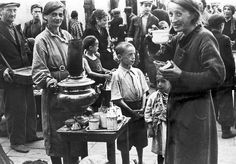 Warsaw, Poland, Jews in a street in the ghetto.  From a collection of photographs taken by the German photographer Willi George in the Warsaw Ghetto during a day in the summer of 1941. The collection is unique in that the photographs are not staged.