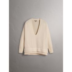 A cable and rib-knit wool sweater spun from a soft wool and cashmere blend. The relaxed fit shaped is enhanced with dropped shoulders and a cut-out V-neck – layer it over an untucked shirt.