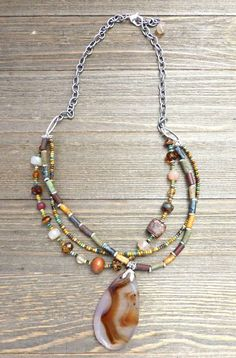 Stone pendant, silver metal, Czech glass. Necklace is 22 inches long and can be adjusted for length with notes to seller at checkout. All of my jewelry is made by me and handmade and with care and lov