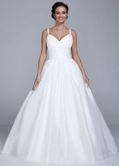 """Beautifully designed this taffeta empire wedding dress will give you a true """"princess"""" moment! Tank taffeta bodice features a ruched empire waist that helps create a stunning silhouette. Ball gown skirt creates tons of drama and finishes off the look. Available in Soft White. Sizes 0-14. Fully lined. Back zip. Imported polyester. Dry clean."""