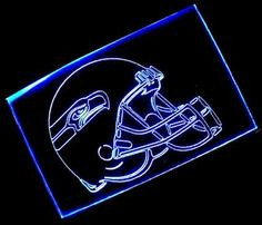NFL- Seattle Seahawks Helmet Neon Light Sign by scopewise co. $65.99. Brand new colored fluorescent 12inches x 9 inches (30cm x 22.5cm) light sign. Attractive when light off and eye-catching when light on. The color of the pictures shown here may vary from monitor to monitor. Metal chain is included for hanging or mounting on wall. Engrave on hard transparent acrylic plastic plate with aluminum tube cover. * Brand new sign, never used * Overall size: Width: 30cm...