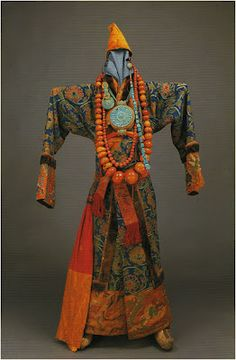 Traditional Tibetan outfit with adornments. This type of attire would have been worn by a local official. Men wore large necklaces and strings of turquoise dangled from their ear.