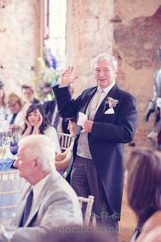 Father of the Groom speech at Lulworth Castle wedding. Photography by one thousand words wedding photographers