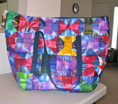 Ribbon quilt tote bag. Custom order. Dog trial ribbons. Horse show ribbons. Ribbon display. Rosettes and awards. Ribbon quilting. Dog agility, dog obedience, dog training, conformation. AKC, 4H, track, swimming, pageants. Ribbon display. Rosettes and awards. Ribbon quilting. Dog agility, dog obedience, dog training, conformation.
