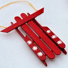 Sled | Materials: Craft  sticks, matchsticks or toothpicks, XACTO knife, ruler, glue gun, paint or markers, Mod Podge or glue, small paint brushes, string or ribbon (for hanging) and sandpaper (optional) | Instructions: http://www.gwennypenny.com/2012/12/popsicle-stick-sled-ornament-tutorial.html