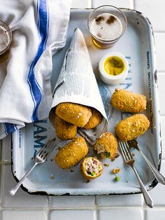 Ham hock and pea croquettes - These ham hock and pea croquettes make the perfect accompaniment to drinks. Try to use a whole ham hock for this so that you can keep the pieces really chunky. Butchers and larger supermarkets sell them ready-cooked.