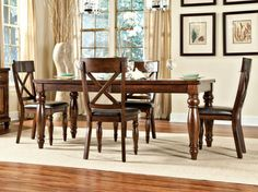 Kingston Dining Sets.  The Distinctive cross-back chair design of this classic yet contemporary all-wood dining room collection set the Kingston apart.  Seats up to 8.  Available at Just Cabinets Furniture & More and online at JustCabinets.com