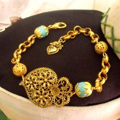 Portuguese Viana Heart filigree style rich gold metal with energy Turquoise stones and filigree beads.$38.00 #portuguesebracelet#vianaheartbracelet#coraçãodeviana#portuguesefiligree#madeinportugal#goodenergybracelet#goldturquoisebracelet#portuguesejewelry#heartofvianafiligree#filigranaportuguesa