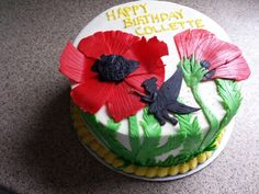 Pixie and poppies cake