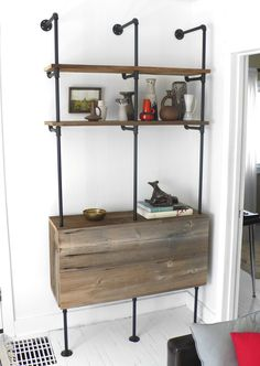 I am loving those pipe shelf diy which are popping up on many cool blogs these days. I love the use of the reclaimed wood here!  #pipes  #shelving