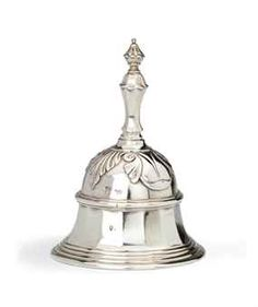 A Dutch silver table-bell  Mark of Bernardus Blencke, Groningen, 1739/40  Of bell-shape with reeded rim, the upper part with stylised leaves, the baluster handle with knop finial, marked on bell  12 cm. high  322 gr.