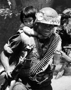 "historywars: "" American soldier carrying a South Vietnamese child """