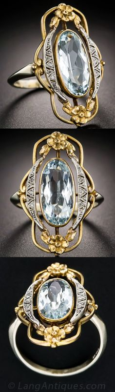 Art Nouveau Aquamarine and Diamond Ring. This stunning and sizable early-twentieth century dinner ring, crafted in platinum over yellow gold with a white gold ring shank, combines Art Nouveau grace and Arts & Crafts artistry to create a singular beauty. A placid pale-blue elongated oval aquamarine floats inside a fanciful and feminine openwork frame accented with twinkling diamond crescents and a pair of golden flowers.