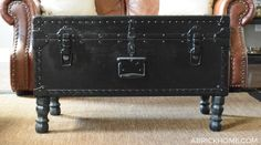Simple DIY: Trunk Repurposed into Ottoman by painting and adding legs!