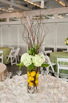 centerpieces- idea of what to do with all the pre-lit branches we have