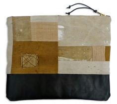 "ITEM: handmade zippered pouch, perfect for larger daily necessities or travel needs.MATERIALS: inspired by the Japanese art of ""boro"" (meaning mended, patched and repaired), this pouch has been assembled with a variety of neutral toned fabrics, from paint spattered artist drop cloth to vintage army duffle and postal bags. Washed-effect black leather bottom and natural canvas lining. Heavy duty brass zipper closure is trimmed with leather cord. All fabrics have been was..."