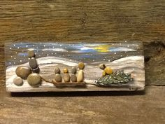 "Pebble art ""Bringing in the Christmas tree"" www.sticksnstonesart.ca, see us on Facebook, #crafts #stone #pebble #board #Christmas #handmade #painting"