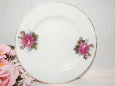 "Beautiful porcelain plate with rose bouquet transfers and hand painted gold trim  5"" diameter with 1/2"" profile  1960's tableware, elegant feminine tea/coffee service accessory or brunch dish.  This would also be a pretty soap dish or trinket/ring ..."