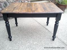 Farmhouse table refinished with black legs and tung-oil finished top.  I could do this....
