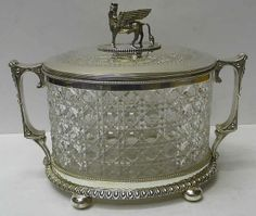 Victorian Silver Plate and Crystal Biscuit Jar        A beautiful antique biscuit box with hinged lid and side  handles. Length 25.5 cms. Width 14 cms. Height 18.5 cms. Circa 1890.