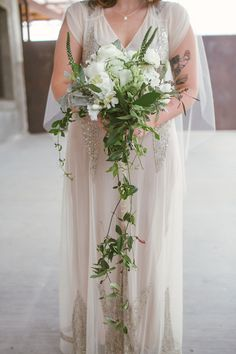 green and white cascading bouquet // photo by Kat Bevel // flowers by Exquisite Petals