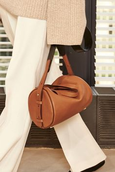 """The Row added a new silhouette to the label's trove of classic, elegant handbags: a midsize """"drum"""" style that models carried insouciantly by its long straps. [Courtesy Photo]"""