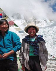 Tamae Watanabe, right, of Japan poses with a photograher Noriyuki Muraguchi at a base camp on the foot of Mt. Everest in Nepal. A 73-year-old Watanabe has climbed Mount Everest, smashing her own record to again become the oldest woman to scale the world's highest mountain.