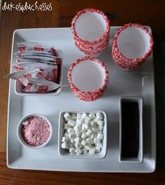 Hot Cocoa with Friends - Styrofoam cups lips are dipped in melting chocolate and them dipped in peppermint flavored sprinkles.