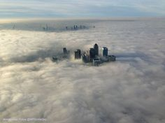 A thick fog blankets London's Canary Wharf business district on Dec. 10, 2013. (METROPOLITAN POLICE | @MPSINTHESKY)
