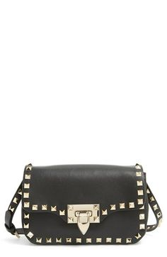Valentino 'Rockstud' Crossbody Bag | Signature pyramid studs trace the clean, modern profile of a sized-down crossbody bag cast in finely grained leather.