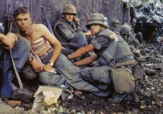 Vietnam War: Wounded US Marine is tended by corpsman during the Tet Offensive, January 1968.