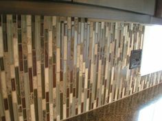 i love the use of this deco tile on the vertical rather than the horizontal - Vertical Tile Backsplash