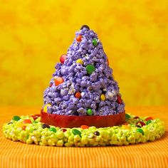 Go for wicked or zany with this edible witch's hat. The concoction is an updated popcorn ball recipe tinted with food coloring pastes and shaped into hat form. For something a little more wicked, use traditional black and orange food coloring pastes. Or, pair vibrant colors for something zany.