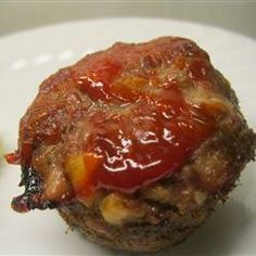 """My Meatloaf from All Recipes. (Emily: This was a hit with my little fam! I used bbq sauce instead of ketchup, which Aaron voted to be a permanent change, and only cooked it for 40 minutes, or when it was done a la' instructions. I like that this one has you tear pieces of bread """"heels are great,"""" instead of using bread crumbs or oatmeal.)"""