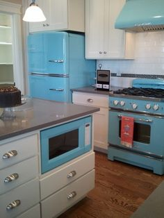 """This kitchen is in the Disney """"Up"""" house- I love the retro appliances!"""
