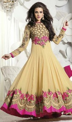 Be the center of attention by sporting this beige color embroidered georgette net long Anarkali churidar suit. The lace, patch and resham work seems chic and great for any event. #lateststylishanarkalidresses #traditionalanarkalisuit #womenanarkalidress