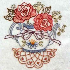 Roses & Ribbons By Bronwyn Hayes  Kit includes DMC stranded cotton, calico, transfer paper, embroidery needle and all instructions.  Stitched area is 13.5 cm x 13 cm  Could be used as a picture, cushion top, or panel in a quilt.