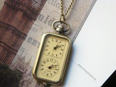 Double clock antique brass pocket watch necklace by CeciliaJewelry