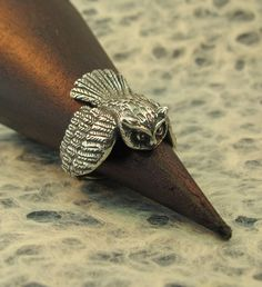 The wings on this solid sterling silver Owl Ring wrap gracefully around the finger. This dramatic ring is beautifully detailed and ready to take flight. -From Etsy